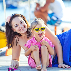 Happy mother with her daughter by the sea