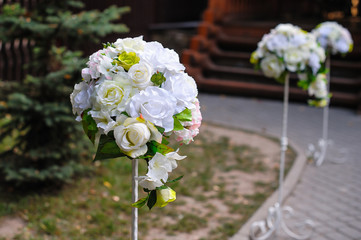 Beautiful white flower arrangements decorated the track for the