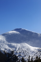 Winter mountains in sunny wind day