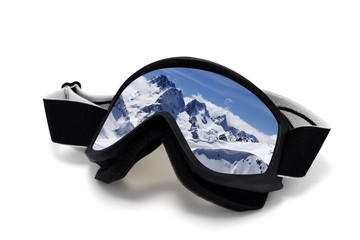 Ski goggles with reflection of winter mountains