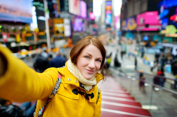 Beautiful woman taking a selfie on Times Square
