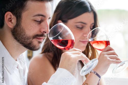 Leinwanddruck Bild Couple at wine tasting.
