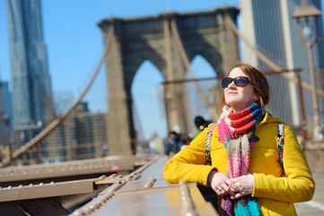 Young woman sightseeing on Brooklyn Bridge