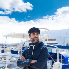 Sailor in marina port with boats background