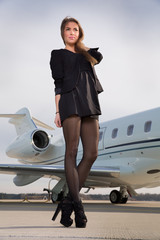 woman in front of a corporate jet