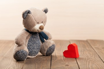 Background. Teddy Bear with red heart shaped box