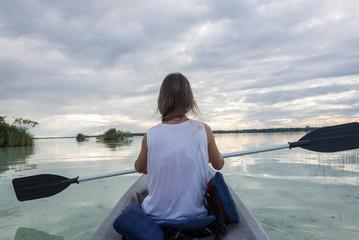 Young Girl Kayaking at Bacalar, near Cancun, Traveling Mexico. B