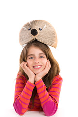 Brunette kid girl student with hedgehog book