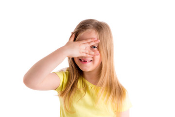 Blond indented kid girl hiding eyes with fingers