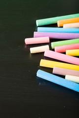 Blackboard. Blackboard with coloured crayons