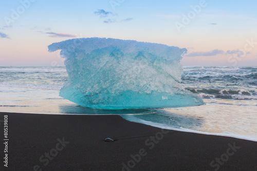 Fotobehang Antarctica 2 Ice cube on black volcano sand beach, Iceland