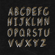 Hand-drawn Shadowed Alphabet on BlackBoard Texture
