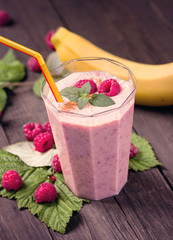 Banana raspberry smoothie on table