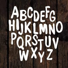 Hand-drawn Alphabet on Wooden Texture