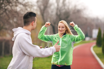 Young female athlete happy to achieve the goal