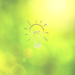Light bulb sketch on abstract blurred background