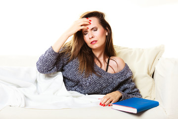 Woman suffering from head pain taking power nap
