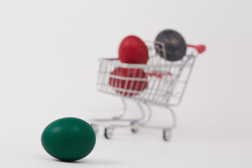 green Easter egg next to the shopping cart