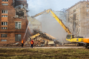 excavator demolishes old school building
