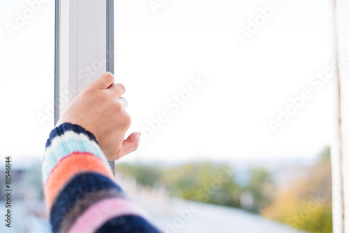 Poster hands close open window