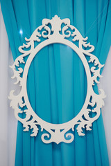 white oval frame carved on a blue background