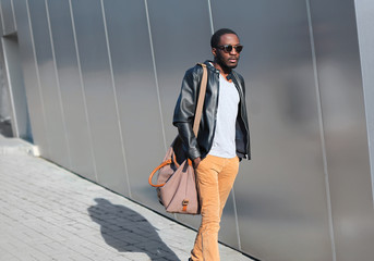 Street fashion concept - handsome stylish young african man