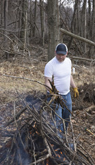 Man burning brush in the woods