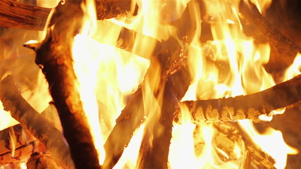 Charming bonfire flame blazing in the night, closeup view