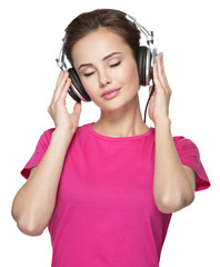 girl enjoys listening to music on headphones