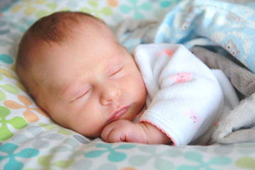 Cozy Sleeping Newborn Baby Girl