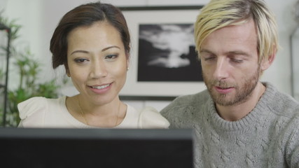 Married couple banking and paying their bills online