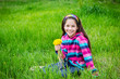 Girl on field with bouquet of dandelions