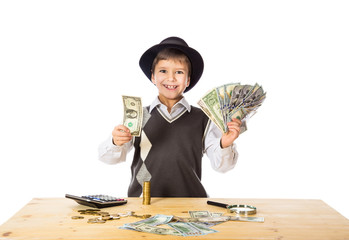 boy counting money on the table