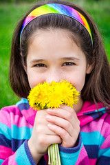 Girl with bouquet of dandelions