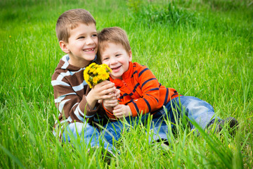 Two boys with dandelions