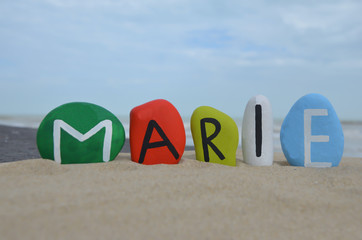 Marie, female name on colored stones