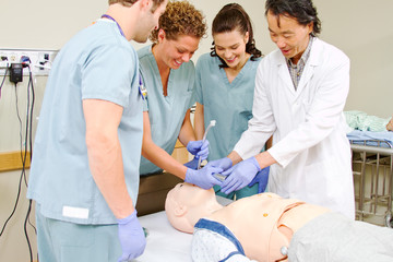 Medical staff practicing intubating mannequin
