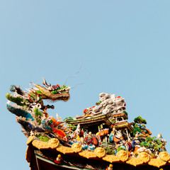 god and dragon art decoration on the roof of chinese temple