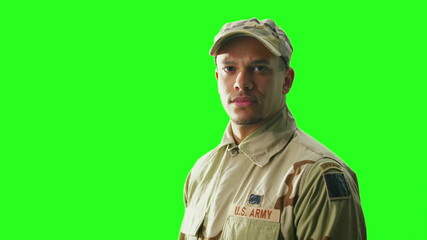Portrait of U.S. Army serviceman isolated on green screen background