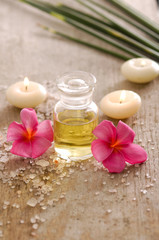 spa set with candle , frangipani and oil