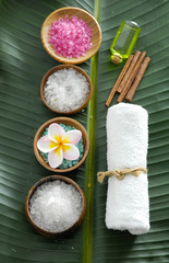 Spa setting with colorful salt in bowl with towel