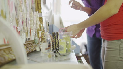 Two attractive young women shopping together and looking at jewelry