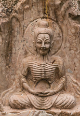 the ancient stone carving for buddha statue
