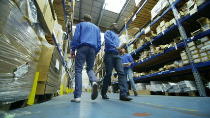 Team of male workers in warehouse or factory