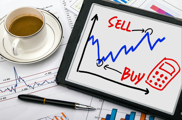stock exchange graph hand drawing on tablet pc