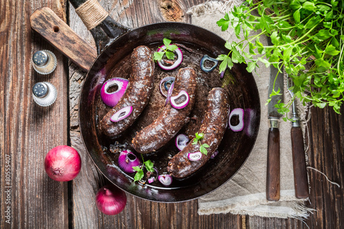 Fototapeta Hot black pudding with onion and parsley