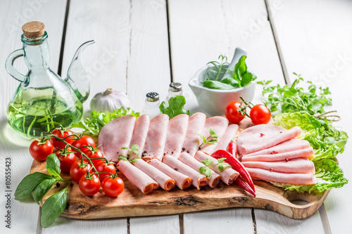 Tasty ham with herbs and pepper
