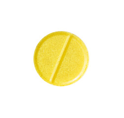 Macro yellow medical pill tablet isolated on white