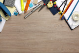 Desk cluttered with office supplies poster