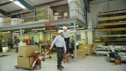 Busy workers in a factory or warehouse